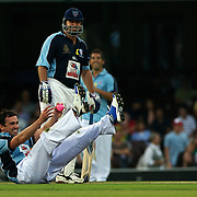 Shannon Noll misses a catching chance as Mark Taylor looks during the Australia's Big Bash Cricket match to raise money for the Victorian Bushfire Appeal at the Sydney Cricket Ground, Sydney, Australia on February 22, 2009. The match was attended by over 20,000 spectators. Photo Tim Clayton