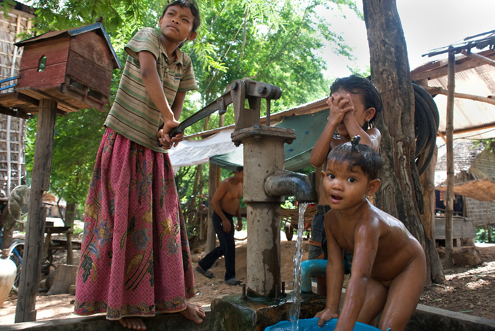 Children pump water in the village of Phnom Krom, just outside of Siem Reap, Cambodia.