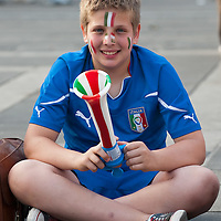 MILAN, ITALY - JUNE 14:  An young Italian fan wearing Italy national team sits in Piazza del Duomo on June 14, 2010 in Milan, Italy. Italy's national football team managed a draw 1-1 against Paraguay in their first match of FIFA 2010Soccer World Cup.
