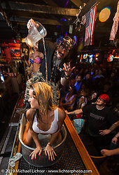 Wet T-shirt contest on the bar at the Dirty Dogg Saloon to help kick off Arizona Bike Week 2014. USA. April 3, 2014.  Photography ©2014 Michael Lichter.