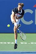 DANIIL MEDVEDEV hits a serve at the Rock Creek Tennis Center.
