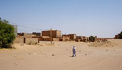 A man in traditional dress in a street scene in Mhamid, Morocco<br /> <br /> (c) Andrew Wilson | Edinburgh Elite media