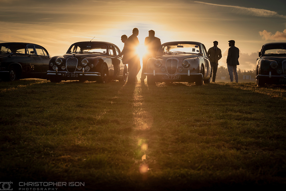 Visitors to the Goodwood Revival in the car park at sunrise.<br /> Picture date: Friday September 17, 2021.<br /> Photograph by Christopher Ison ©<br /> 07544044177<br /> chris@christopherison.com<br /> www.christopherison.com<br /> <br /> IMPORTANT NOTE REGARDING IMAGE LICENCING FOR THIS PHOTOGRAPH: This image is supplied to the client under the terms previously agree. No sales are permitted unless expressly agreed in writing by the photographer.