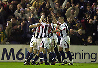 Photo. Richard Lane.<br />West Bromwich Albion v Manchester United. Carling Cup 4th Rd. 03/12/2003.<br /><br />West Brpm players mob Scott Dobie (centre) after he scored his teams second goal against Manchester United.