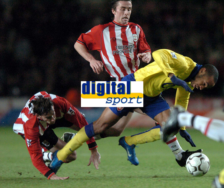 Photo: Richard Lane.<br />Southampton v Arsenal. Barclaycard Premiership.<br />29/12/2003.<br />Thierry Henry is sent flying by Rory Delap.