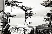 woman in Kimono at a river lookout  Japan 1960s