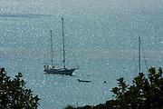 Ketch rigged sailing yacht at anchor in Kaneohe Bay, Oahu, Hawaii