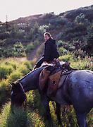 "Amanda Cornell with horses ""Scout"" and ""Shorty,"" Caribou Creek, Talkeetna Mountains, Alaska."