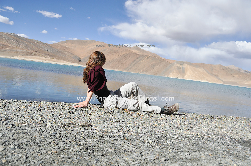 Young European tourist on the shores of Pangong Tso (Pangong lake), India, Jammu and Kashmir, Ladakh