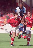 Paulo Wanchope (Manchester City) can find no way through the Charlton defence with close marking from Steve Brown (left) and Mark Kinsella (right). Charlton Athletic v Manchester City, 19/8/2000. Credit: Andrew Cowie / Colorsport.