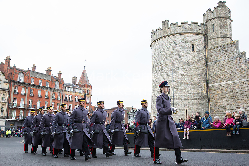 Windsor, UK. 21st February, 2019. 36 Engineer Regiment Queen's Gurkha Engineers, accompanied by the Band of the Brigade of Gurkhas, take part in the Changing of the Guard ceremony at Windsor Castle. The Queen's Gurkha Engineers will provide the Windsor Guard until April 12th, for the first time since the celebrations marking 200 years of service to the Crown in 2015.