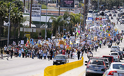 April 29, 2017 - Los Angeles, California, U.S - Thousands people participate in ''People's Climate March'' a climate change awareness march and rally, in Los Angeles, Saturday, April 29, 2017. The gathering was among many others of its kind held nationwide marking President Donald Trump's 100th day in office. (Credit Image: © Ringo Chiu via ZUMA Wire)