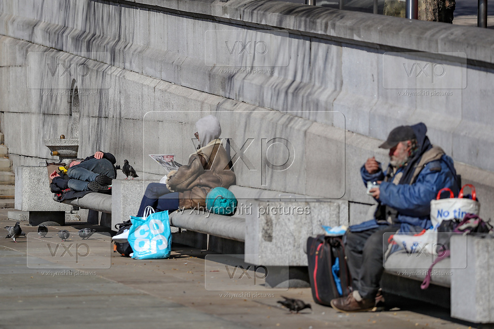 """Three hundred rooms have been made available in two hotels for the next 12 weeks, the London mayor's office said in a statement last week, but homeless people are seen on Wednesday, March 25, 2020, nearby Trafalgar Square in Westminster. They are at particular risk of contracting the coronavirus with the systems that care for them poorly equipped to handle a major outbreak. Vigilant hygiene can prevent transmission, health experts say, but that is likely to be a challenge for people living without homes. An estimated 320,000 people are homeless in the UK, according to the latest research by charity """"Shelter"""". This equates to one in every 201 Brits and was an increase of four per cent on the previous year's number.<br /> (Photo/Vudi Xhymshiti)"""