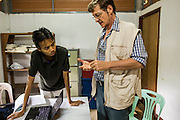 20 MAY 2013 - MAE KASA, TAK, THAILAND:  Burmese Dr. AUNG PYAE PHYO and Dr. FRANCOIS NOSTEN consult about malaria at the SMRU clinic in Mae Kasa, Thailand. Health professionals are seeing increasing evidence of malaria resistant to artemisinin coming out of the jungles of Southeast Asia. Artemisinin has been the first choice for battling malaria in Southeast Asia for 20 years. In recent years though,  health care workers in Cambodia and Myanmar (Burma) are seeing signs that the malaria parasite is becoming resistant to artemisinin. Scientists who study malaria are concerned that history could repeat itself because chloroquine, an effective malaria treatment until the 1990s, first lost its effectiveness in Cambodia and Burma before spreading to Africa, which led to a spike in deaths there. Doctors at the Shaklo Malaria Research Unit (SMRU), which studies malaria along the Thai Burma border, are worried that artemisinin resistance is growing at a rapid pace. Dr. Aung Pyae Phyo, a Burmese physician at a SMRU clinic just a few meters from the Burmese border, said that in 2009, 90 percent of patients were cured with artemisinin, but in 2010, it dropped to about 70 percent and is now between 55 and 60 percent. He said the concern is that as it becomes more difficult to clear the parasite from a patient, progress that has been made in combating malaria will be lost and the disease could make a comeback in Southeast Asia.    PHOTO BY JACK KURTZ