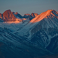Mount Sill and the Palisade Glacier glow in morning light dawing on the eastern Sierra Nevada crest in California.