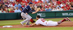 August 22, 2017 - St Louis, MO, USA - The St. Louis Cardinals' Tommy Pham loses his helmet as he slides safely into third on a flyout by Paul DeJong as San Diego Padres third baseman Cory Spangenberg receives the throw in the first inning on Tuesday, Aug. 22, 2017, at Busch Stadium in St. Louis. (Credit Image: © Chris Lee/TNS via ZUMA Wire)