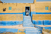 Hajja Fatma infront of her home in Besion, Gharb Aswan