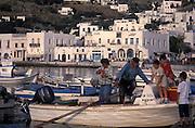 2004, Mykonos Town, Mykonos, Greece --- A fisherman returns home in Mykonos, Greece. --- Image by © Jeremy Horner