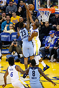 Golden State Warriors forward Kevin Durant (35) stops a dunk by Memphis Grizzlies guard Ben McLemore (23) at Oracle Arena in Oakland, Calif., on December 20, 2017. (Stan Olszewski/Special to S.F. Examiner)