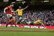 Bernard Foley of Australia dives over to score his try in the 2nd half. Under Armour 2016 series international rugby, Wales v Australia at the Principality Stadium in Cardiff , South Wales on Saturday 5th November 2016. pic by Andrew Orchard, Andrew Orchard sports photography