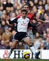 Photo: Leigh Quinnell.<br /> Tottenham Hotspur v Charlton Athletic. The Barclays Premiership. 05/02/2006. Tottenhams Aaron Lennon is under presure from Charltons Luke Young.