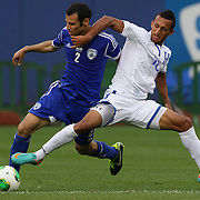 Diego Reyes, Honduras, (right), is tackled by Shpungin Yuval, Israel, in action during the Israel V Honduras  International Friendly football match at Citi Field, Queens, New York, USA. 2nd June 2013. Photo Tim Clayton
