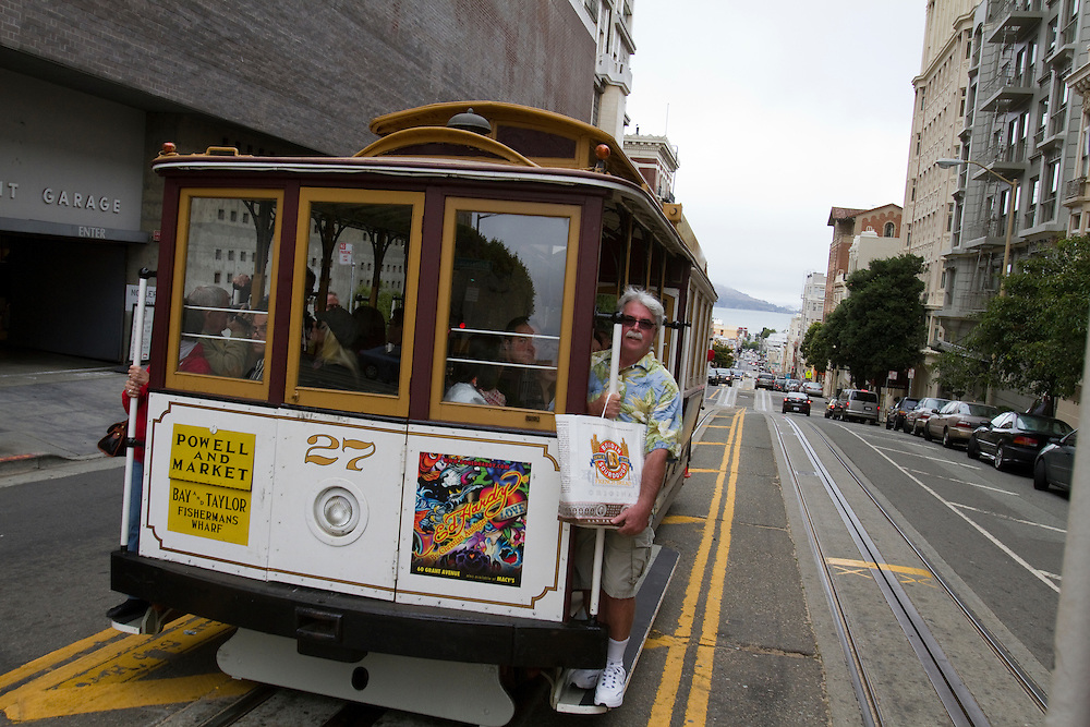 Riders on San Francisco's famous cable cars.