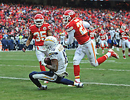KANSAS CITY, MO - NOVEMBER 24:  Wide receiver Seyi Ajirotutu #16 of the San Diego Chargers catches a 26-yard touchdown pass against safety Kendrick Lewis #23 of the Kansas City Chiefs during the second half on November 24, 2013 at Arrowhead Stadium in Kansas City, Missouri.  San Diego won 41-38. (Photo by Peter Aiken/Getty Images) *** Local Caption *** Seyi Ajirotutu;Kendrick Lewis