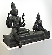 Somaskanda India, Tamil Nadu, Chola style, 12th century, bronze.  The term Somaskanda refers to Shiva and means 'with Uma and Skanda'.  In this particular presentation, Shiva and Uma sit on a rectangular pedestal, with the child Skanda standing between them.  This representation developed in Southeast India and was particularly popular during the 10th-13th centuries.  On feast days these images were carried in procession around the city.