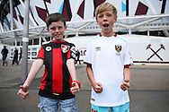 a Young Bournemouth & young West Ham United fan pose for a photo outside London Stadium before k/o. Premier league match, West Ham Utd v AFC Bournemouth at the London Stadium, Queen Elizabeth Olympic Park in London on Sunday 21st August 2016.<br /> pic by John Patrick Fletcher, Andrew Orchard sports photography.