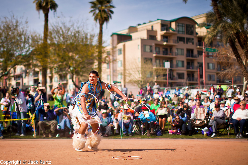 06 FEBRUARY 2011 - PHOENIX, AZ: PANIKA TEEPLE-BAILEY, from the Bay Mills Indian Community, performs at the 21st Annual Heard Museum World Championship Hoop Dance Contest at the Heard Museum in Phoenix, AZ, Sunday, February 6. Hoop dancing has a long tradition among Native American peoples. The hoop or circle is symbolic to most Native people. It represents the Circle of Life and the continuous cycle of summer and winter, day and night, male and female. Some native people use hoop dancing as a part of healing ceremonies designed to restore balance and harmony in the world.      Photo by Jack Kurtz