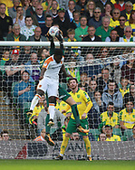 Norwich City's 'keeper Angus Gunn saves from Hull City's Nouha Dicko during the EFL Sky Bet Championship match between Norwich City and Hull City at Carrow Road, Norwich, England on 14 October 2017. Photo by John Marsh.