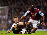 Photo: Daniel Hambury.<br />West Ham United v Liverpool. The Barclays Premiership. 26/04/2006.<br />West Ham's Nigel Reo-Coker and Liverpool's Fernando Morientes  battle.