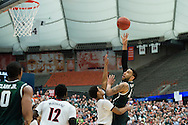 29 MAR 2015: Denzel Valentine (45) of Michigan State University shoots over Quentin Snider (2) of University of Louisville during the 2015 NCAA Men's Basketball Tournament held at the Carrier Dome in Syracuse, NY. Michigan State defeated Louisville 76-70 to advance. Brett Wilhelm/NCAA Photos