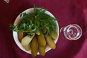 Moscow, Russia, 28/03/2012..Pickled cucumber and vodka in the Oblomov Russian restaurant.