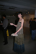 Erin O'Connor. Silent auction reception in aid of the Aids charity  Clothesline.  The Hospital. London. 19  September 2005. ONE TIME USE ONLY - DO NOT ARCHIVE © Copyright Photograph by Dafydd Jones 66 Stockwell Park Rd. London SW9 0DA Tel 020 7733 0108 www.dafjones.com
