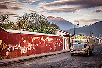 Colourful chicken buses contrast the gorgeous old architecture and cobblestone streets of Antigua, Guatemala.