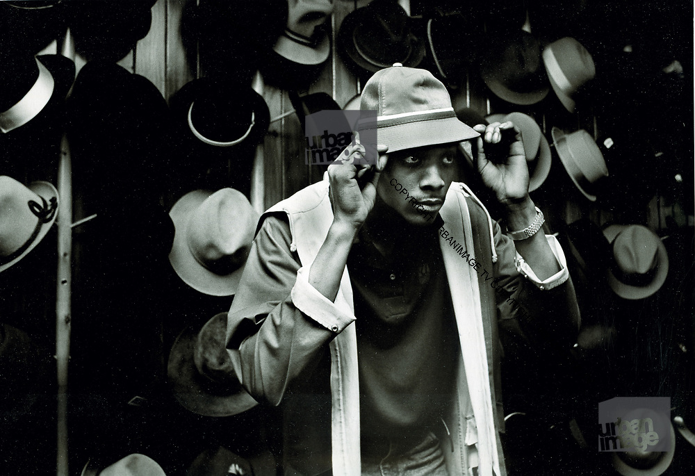 Trying on hats in hat shop. Photo by Richard Saunders 1983