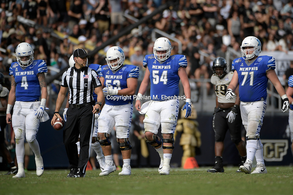 Memphis quarterback Riley Ferguson (4), offensive lineman Dustin Woodard (53), offensive lineman Drew Kyser (54) and offensive lineman Gabe Kuhn (71) set up for a play during the first half of the American Athletic Conference championship NCAA college football game Saturday, Dec. 2, 2017, in Orlando, Fla. (Photo by Phelan M. Ebenhack)