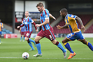 Scott Laird of Scunthorpe United of Scunthorpe United and Abu Ogogo of Shrewsbury Town during the Sky Bet League 1 match between Scunthorpe United and Shrewsbury Town at Glanford Park, Scunthorpe, England on 17 October 2015. Photo by Ian Lyall.