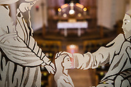Etched glass artwork depicting Jesus Christ and the little children (Mark 10:14, Matthew 19:14) with the altar and baptismal font at Gethsemane Lutheran Church on Tuesday, July 28, 2020, in St. Louis.  LCMS Communications/Erik M. Lunsford
