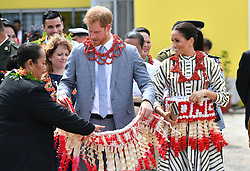 RETRANSMITTED WITH NAME OF GARMENT ADDED The Duke and Duchess of Sussex are given ta'ovala, a traditional Tongan dress wrapped around the waist, as they visit an exhibition of handicrafts, mats and tapa cloths at the Fa'onelua Convention Centre on the second day of the royal couple's visit to Tonga.