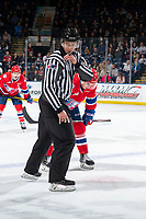 KELOWNA, BC - JANUARY 31: Linesman Jade Portwood blows the whistle for the face-off between the Spokane Chiefs and the Kelowna Rockets at Prospera Place on January 31, 2020 in Kelowna, Canada. (Photo by Marissa Baecker/Shoot the Breeze)