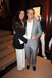 ELIZABETH SALTZMAN and her husband TOM WALKER at the Ralph Lauren Wimbledon Party held at Ralph Lauren, 1 New Bond Street, London on 17th June 2010.