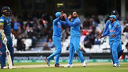 June 8, 2017 - London, United Kingdom - Kedar Jadhav of India celebrates the run out of Danushka Gunathilaka of Sri Lanka. during the ICC Champions Trophy match Group B between India and Sri Lanka at The Oval in London on June 08, 2017  (Credit Image: © Kieran Galvin/NurPhoto via ZUMA Press)