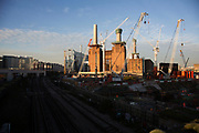 Redevelopment of Battersea Power Station and its surroundings in London, England, United Kingdom. Battersea Power Station is a decommissioned coal-fired power station located on the south bank of the River Thames, in Nine Elms, Battersea, an inner-city district of South West London. Now a construction site and under development, the site will become both residential and commercial.
