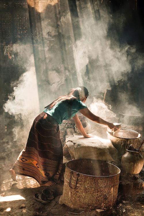 Young Woman baking rice crackers at Inle Lake, Burma 2008
