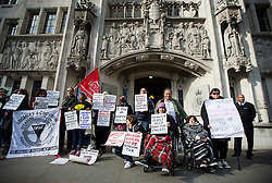 © Licensed to London News Pictures. 29/02/2016. London, UK.  Campaigners gather outside the Supreme Court in London where Justices are due to hear appeals against the under occupancy subsidy, also known as the bedroom tax.  Campaigners believe the reduction in benefits for people in a housing association property that has one or more spare bedrooms, is having a devastating impact on vulnerable people.  Photo credit: Ben Cawthra/LNP