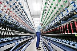 April 25, 2018 - Nanton, China - An employee at work at the intelligent wool spinning workshop of Dasheng Group in Nantong, east China's Jiangsu Province. (Credit Image: © SIPA Asia via ZUMA Wire)