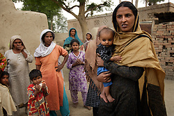 Mukhtar Mai, 33, visits an aunt and family members she hadn't seen for four years, Meerwala, Pakistan, April 28, 2005. Mai, went against the Pakistani tradition of committing suicide when she brought charges against the men who gang raped her nearly three years ago. She has limited her movements because of threats made against her. With money from the ruling she opened two schools, one for girls, the other for boys, citing that education is the only thing that will stop such acts from happening.
